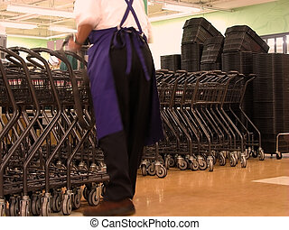 Supermarket worker - Motion blur abstract of a worker in a...