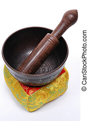 Tibetan Singing Bowl placed on its pillow with wood mallet.