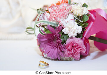 Wedding Ring and Bouquet - Bridal bouquet and wedding ring...