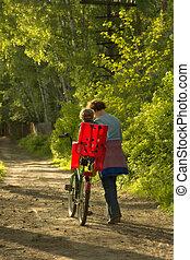 Boy with mum on a wood footpath