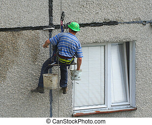 renovation worker on a block of flats 2
