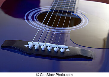 acoustic guitar - Close up on an acoustic guitar