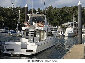 A boat docked in Hamilton Island marina - Hamilton Island...
