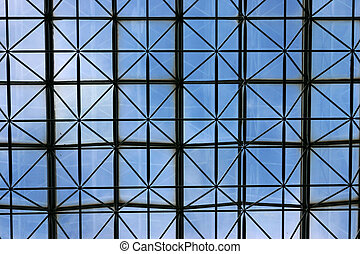 Ceiling of business building with meshed criss cross...