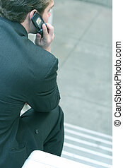 Business man talking on cell phone 3 - Business man in gray...