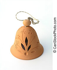 Christmas bell in ceramics with string on white background