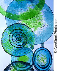 Glass wind chimes - Blue and green glass plates hanging like...