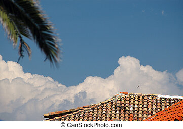 tile roof with tree and bird in clouds