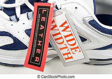 Shoes with labelstabs - Close up of a pair of sport shoes