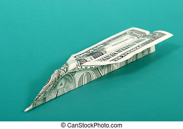 Paper Money Airplane 1 - US dollar bill folded into a paper...