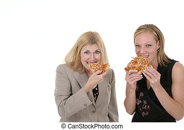 Two Business Women Eating Pizza - Attractive and beautiful...