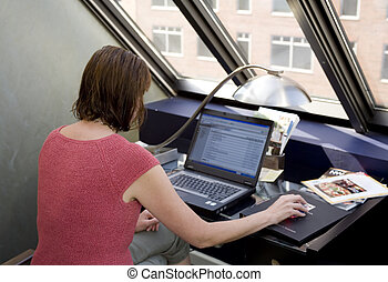 Stock Photo of a Woman Using Laptop - Photo of a woman...