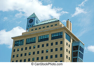 Office Building with Clock - office building with blue sky...