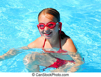 Girl swimming - Girl in red goggles in swimming pool
