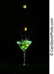 Martini - Olives dropping into martini glass, stop motion