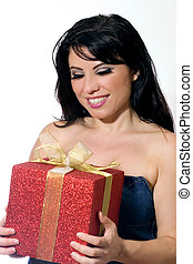 Woman holding a gift. - Woman holding a red and gold gift.