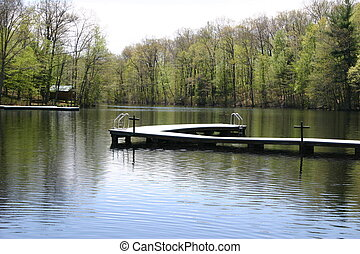 Summer Lake - A lake and a wooden dock.