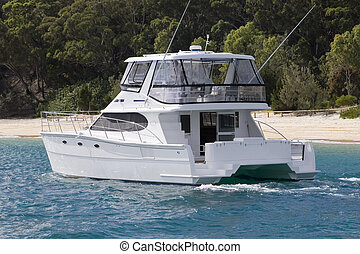 Moreton Island Power Yact - A power yacht pulls up to...