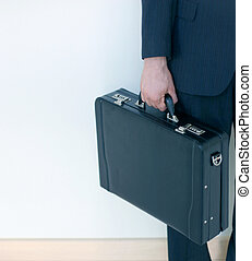 Business briefcase 4 - Business man holding briefcase in...