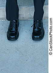 Business shoes 3 - Business man wearing black shoes on...