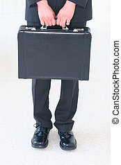 Businessman with briefcase 7 - Business man in black suit...