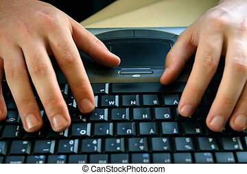 Business man with laptop 32 - Business man is typing on his...