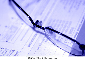 Business glasses - Glasses on top of contract in purple hue