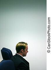 Business leader 11 - Blond hair business man is sitting in...