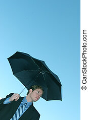Business rain - Young business man is wearing black suit and...