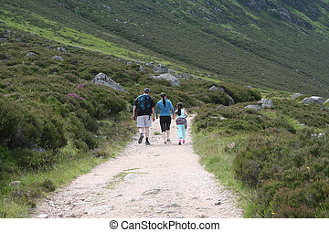 family walking in the mountains