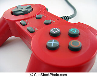 red controller - a red video game controller isolated over...