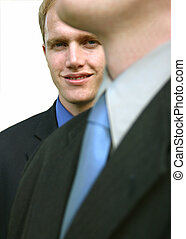 Business leader 37 - Business man is behind another...
