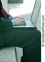 Businessman with laptop 48 - Businessman is wearing a red...