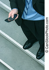 Businessman with cellphone 15 - Businessman in dark suit is...