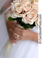 Bride holding bouquet 3 - Bride is holding a bouquet of...