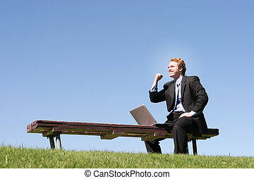 Businessman with laptop 45 - Business man in black suit and...