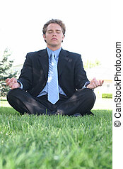 Business zen 2 - Businessman in black suit is sitting in...