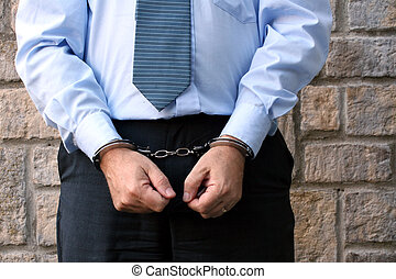 Cuffed - Businessman in handcuffs