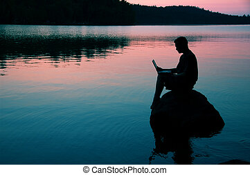 On the lake - man with laptop