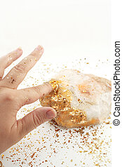 golden touch - golden fingertip turns rock into gold