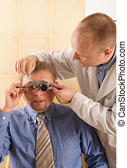 optician and patient - Optician looking for proper...