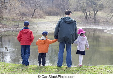 Children with father in park
