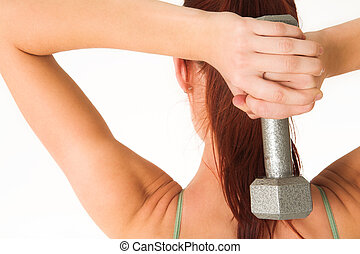 Gym #1 - A woman in gym clothes, holding a weight behind her...
