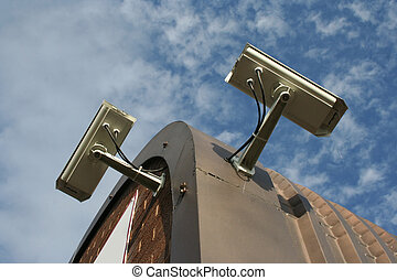 roof mounted CCTV cameras against sky