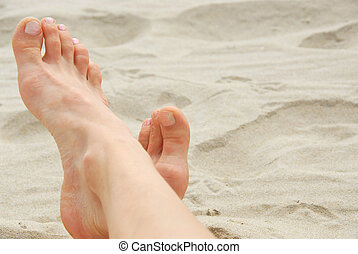 Woman feet beach - Womans feet on a sandy beach