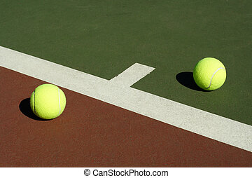 Two tennis balls in a tennis court