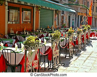 Empty Tables - Tables at a sidewalk cafe ready for customers