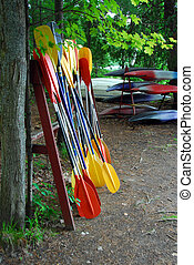 Kayak paddles and kayaks at camp