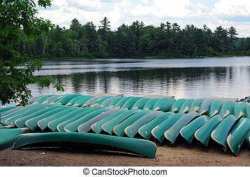 Canoes on lake shore in northern Ontario