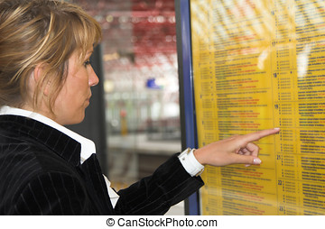 Checking the schedule - Pretty businesswoman checking the...